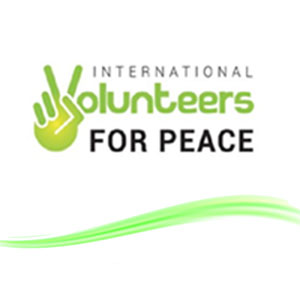 International Volunteers for Peace logo. Green hand making a peace sign.
